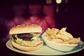 Hamburger and french fries plate in american food restaurant - PhotoDune Item for Sale