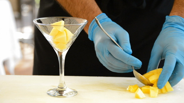 Professional Hands Preparing a Cocktail