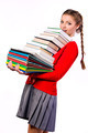 girl standing with a bunch of books - PhotoDune Item for Sale