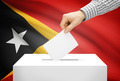 Voting concept - Ballot box with national flag on background - East Timor - PhotoDune Item for Sale