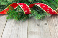 Christmas fir tree branches on wooden board - PhotoDune Item for Sale