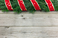 Christmas background with fir tree and ribbon on wood - PhotoDune Item for Sale