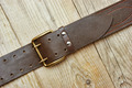 leather belt with a buckle on a wooden board - PhotoDune Item for Sale