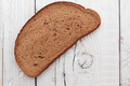 slices of rye bread on a wooden table - PhotoDune Item for Sale