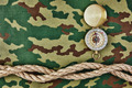 Compass and rope on a camouflage background - PhotoDune Item for Sale