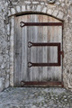 Old wooden door in the entrance stone French house - PhotoDune Item for Sale