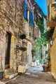 Narrow street with flowers in the old town Mougins in France. Ni - PhotoDune Item for Sale