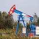 oil pump jack on windy field - PhotoDune Item for Sale