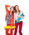 Two young girl friends standing having fun together - PhotoDune Item for Sale