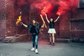 Two aggressive women with Molotov cocktail bomb in the street - PhotoDune Item for Sale
