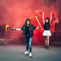 Two women protesters with Molotov cocktail bomb in the street - PhotoDune Item for Sale