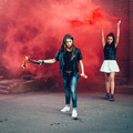 Two Bad fan girls with Molotov cocktail bomb in the street - PhotoDune Item for Sale