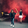 Two Bad fan girls with Molotov cocktail and red smoke bomb - PhotoDune Item for Sale