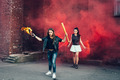 Two young fans with Molotov cocktail and red smoke bomb - PhotoDune Item for Sale
