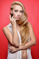 Beautiful seminude blonde woman at red background. - PhotoDune Item for Sale