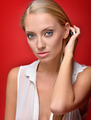 Portrait of the beautiful blonde woman in studio - PhotoDune Item for Sale