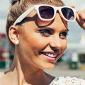Young woman with sunglasses smiling - PhotoDune Item for Sale