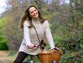 Beautiful woman enjoying nature driving bicycle - PhotoDune Item for Sale