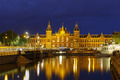 Night city view of Amsterdam canal and Centraal Station - PhotoDune Item for Sale