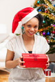Young African American woman holding a gift box - Black people - PhotoDune Item for Sale