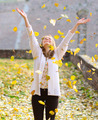 Happy woman enjoying autumn in park - PhotoDune Item for Sale