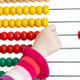 Kid's hand with colorful abacus isolated - PhotoDune Item for Sale