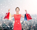 smiling woman with colorful shopping bags - PhotoDune Item for Sale
