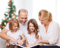 happy family with book at home - PhotoDune Item for Sale