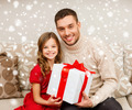 smiling father and daughter holding gift box - PhotoDune Item for Sale