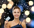 smiling woman in evening dress holding credit card - PhotoDune Item for Sale