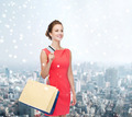 smiling woman with shopping bags and plastic card - PhotoDune Item for Sale