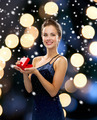 smiling woman holding red gift box - PhotoDune Item for Sale