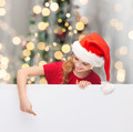 girl in santa helper hat with blank white board - PhotoDune Item for Sale