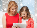 mother and daughter with tablet pc at home - PhotoDune Item for Sale
