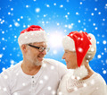 happy senior couple in santa helper hats - PhotoDune Item for Sale