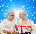 happy senior couple with gift box at home - PhotoDune Item for Sale