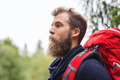 smiling man with beard and backpack hiking - PhotoDune Item for Sale