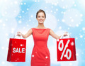 young woman in red dress with shopping bags - PhotoDune Item for Sale