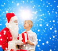 smiling little boy with santa claus and gifts - PhotoDune Item for Sale