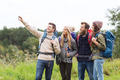 group of friends with backpacks taking selfie - PhotoDune Item for Sale