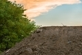 Large pile of soil under blue sky - PhotoDune Item for Sale