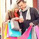 Happy couple shopping in the city with smartphone - PhotoDune Item for Sale