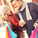 Joyful couple shopping in the city with smartphone - PhotoDune Item for Sale