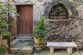 Entrance to the old French house with flowers - PhotoDune Item for Sale