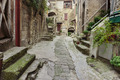 Narrow cobbled streets in the old village Gourdon, France - PhotoDune Item for Sale