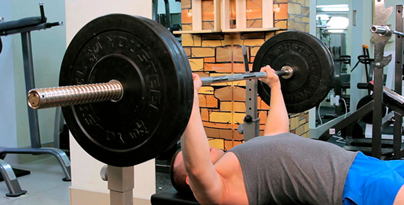 Man Does Bench Press Barbell 3