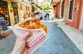 greek pie in hand - walking the streets  - PhotoDune Item for Sale