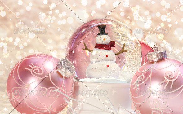 Snow globe with pink ornaments - Stock Photo - Images