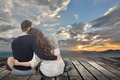 Asian young couple sit and hug together - PhotoDune Item for Sale