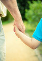 Back view of child and senior man holding hand - PhotoDune Item for Sale